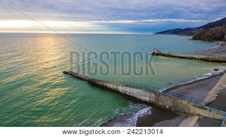 Drone View Of Black Sea With Moles And The Pebble Beach In Cloudy Day, Sochi, Russia
