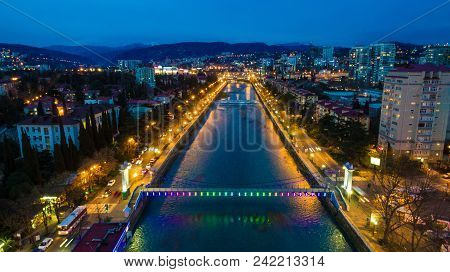 Drone View Of Malyy Kubanskiy Bridge Over Sochi River, Buildings And Streets Of The City Of Sochi At