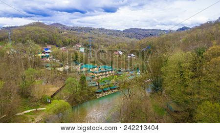 Drone View Of The Village In The Mountains On The Shore Of Khosta River In Cloudy Day, Sochi, Russia