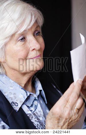 Senior lady reading a document