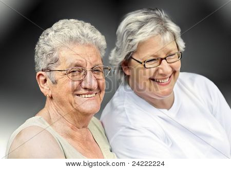 Senior woman and mature woman portrait, on  grey background with white hair