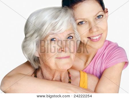 Grandmother and granddaughter looking at camera together,smiling