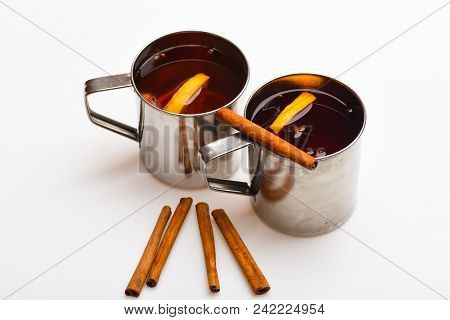 Mulled Wine Or Beverage With Cinnamon. Mugs With Mulled Wine Or Hot Drink And Cinnamon Aroma Sticks,