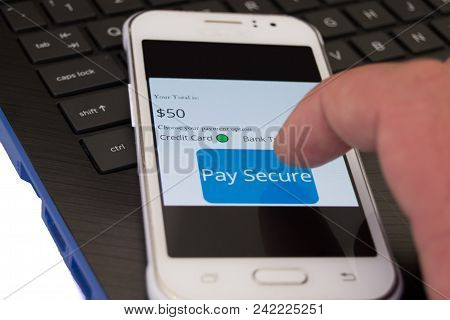 Pay Secure Online Concept Of Cellphone On Latop Keyboard With Different Payment Options To Choose Fr