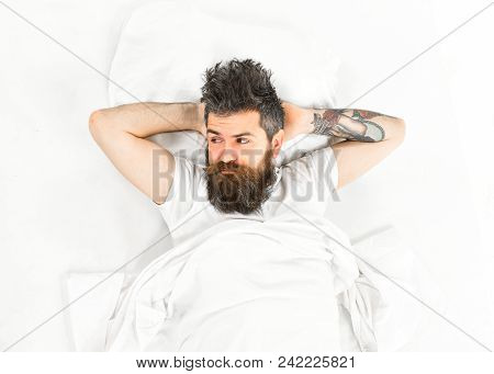 Man With Pensive Face Wake Up, Lay On Bed, Put Hands Behind Head, Top View. Hipster With Beard, Must