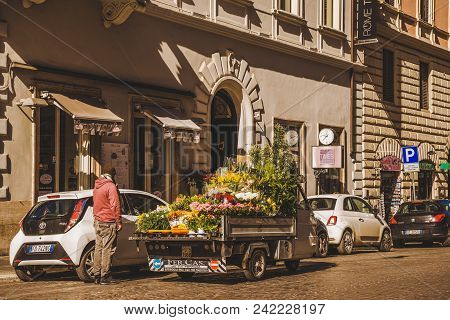 Rome, Italy - 10 March 2018: Man Selling Flowers From Truck On Street Of Rome