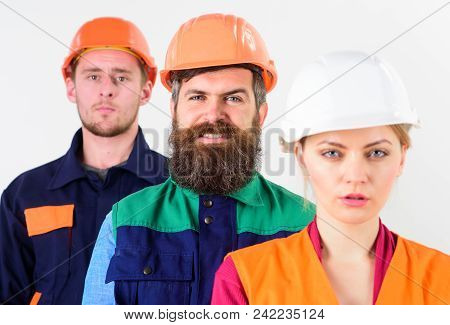 Diversity In Collective Concept. Woman And Men In Hard Hats Stand Close As Team. Different People In