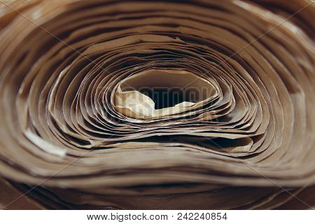 Paper Background. Abstract Paper Background. Cropped Shot Of Paper Roll. Craft Paper Folded In Roll.