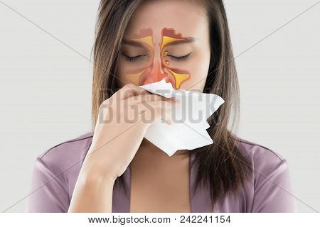 Asian Women In Satin Robes Feeling Unwell And Sinus Against Gray Background. Dust Allergies. Flu. Pe