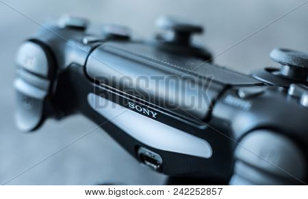 Khakiv, Ukraine - 02 May 2018: Close-up of black authentic dualshock game controller. Sony Playstation PS gamepad