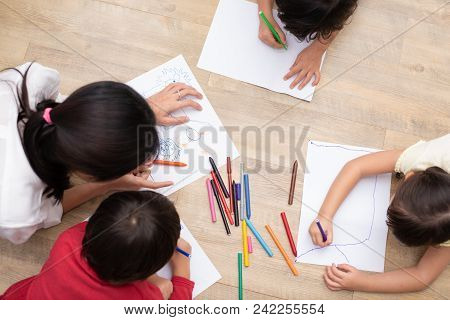Group Of Preschool Student And Teacher Drawing On Paper In Art Class. Back To School And Education C