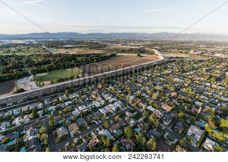 Aerial view of Encino, the Ventura 101 Freeway and Sepulveda Basin in the San Fernando Valley area of Los Angeles, California.