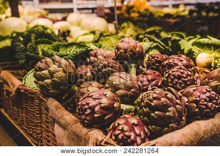 Close-up Shot Of Fresh Artichokes Selling On Farmers Market, Rome, Italy