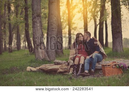 Couple With Picnic Basket.