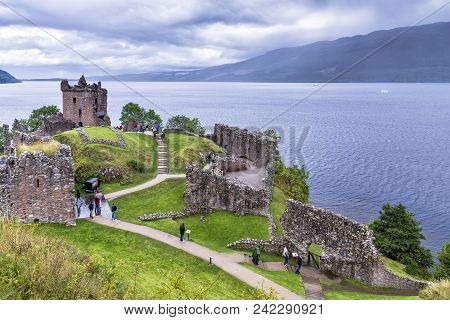 Drumnadrochit, United Kingdom - August 19, 2014: View Of Urquhart Castle Ruins Beside Loch Ness, In