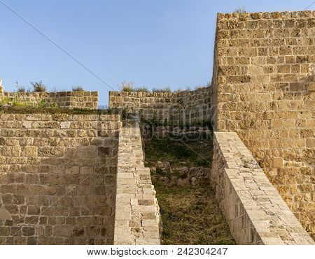 Acre, Israel - March 23, 2018: Old Acre City Walls, Israel. A Heavy Land Defensive Wall With Cannon