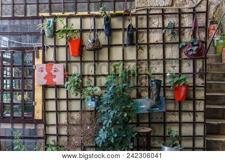 Acre, Israel - March 23, 2018: Flowers And Painting On The Wall In The Old City Of Akko