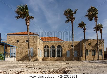 Acre, Israel - March 23, 2018: Ancient Building And Palm Trees In The Old City Of Akko