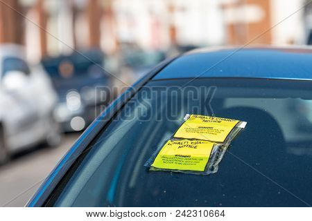 Penalty Charge Notice On Car Windscreen Parked On British Road In England.