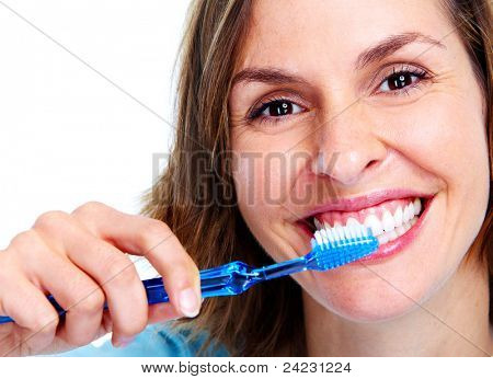 Young woman with toothbrush. Isolated over white background.