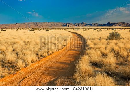 Scenic View Of A Sand Road In Landscape Desert At Sunset. Solitaire, Namibia, Africa.