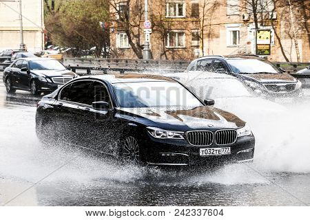 Moscow, Russia - May 2, 2018: Motor Car Bmw (g12) 7-series In The City Street During A Heavy Rain.
