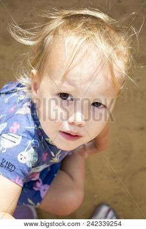 Little Almost Crying Toddler With Big Brown Eyes