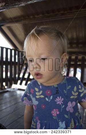 Little Serious Toddler Thinking Of Something Important