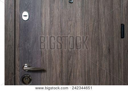 Closed Door.dark Brown Wooden Door Closeup. Modern Interior Design, Door Handle. New House Concept.