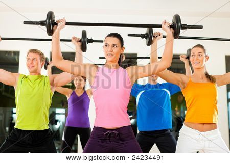 poster of Group of five people exercising using barbells in gym or fitness club to gain strength and fitness