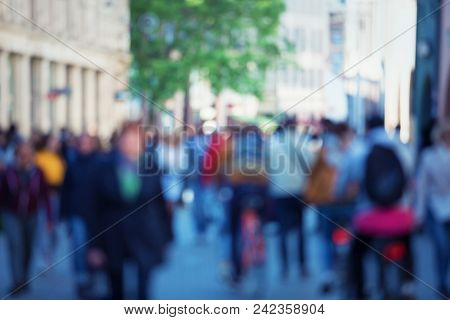 Vintage Tone Abstract People Crowd Background With Blur Effect Applied. Unrecognizable Man And Woman