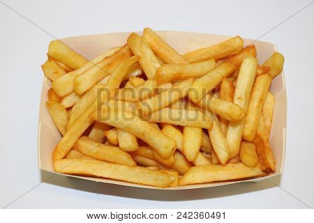 French Fries. Fried Potato. French Fries Close Up. Image Of  French Fries On A White Background.
