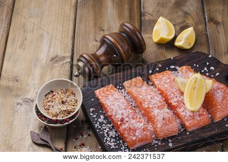 Raw Salmon Fillet With Pepper Sweetbread And Salt On Baking Paper Rustic Theme With Copy-space