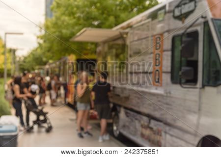 Abstract Blurred Food Truck Vendor With Customer Buy And Taste Variety Of Food