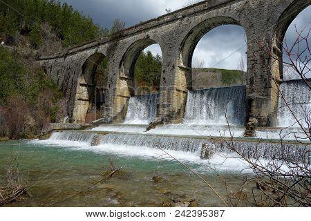 A Weir In A River. A Non-urban Scene Day.