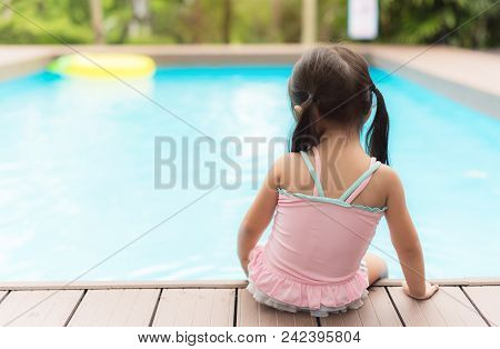 Little Girl On Watter Pool In The Summer Day.