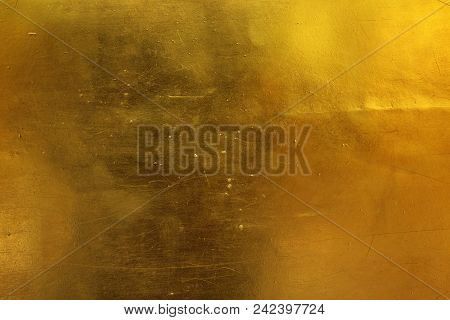 Golden Sheet With Scratches Texture Use For Background