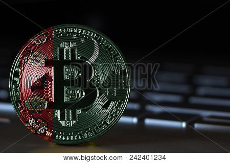 Bitcoin Close-up On Keyboard Background, The Flag Of Turkmenistan Is Shown On Bitcoin.