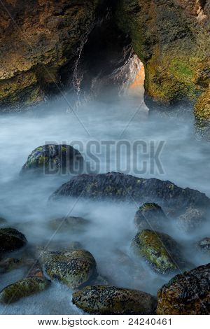 Small Cave At Sea Shore Background