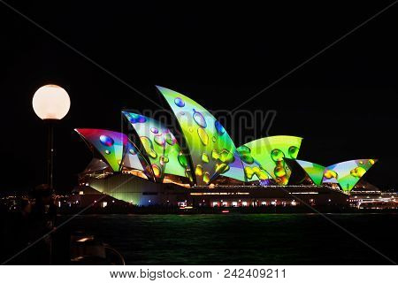 Sydney, Australia - May 25 2018: Tourists Taking In The Sydney Opera House Lights On The Opening Nig