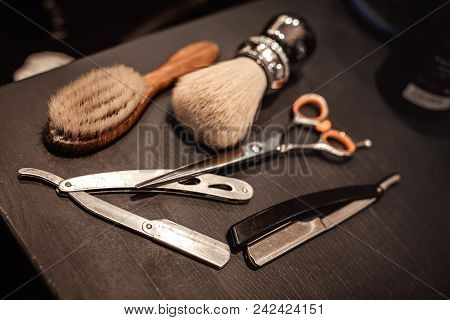 Shaving Accessories And Tools Of Barber Shop On Wooden Background