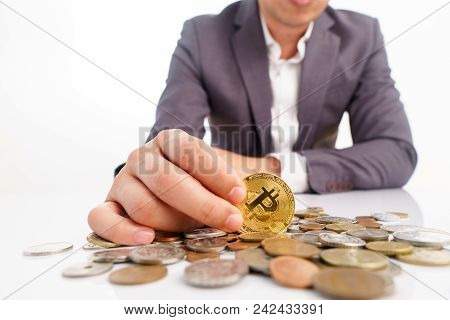 Bitcoin In Business Hand On Another Currency Coin