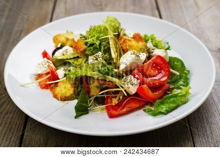 Appetizind Fresh Vegetable Salad With Letuce, Croutons And Feta Cheese. Mediterranean Food, Appetize