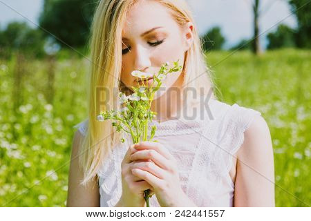 Beautiful Young Blonde Girl In Field Enjoying The Sun And Smelling The Flowers In Hand, White, Trans