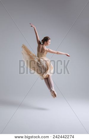 Moment When You Feel Alive! Young Graceful Woman Ballet Dancer, Dressed In Professional Outfit, Shoe