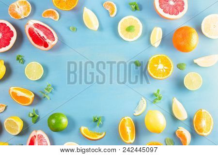 Citrus Food Flat Lay Frame Layput On Blue Background - Assorted Citrus Fruits With Mint Leaves