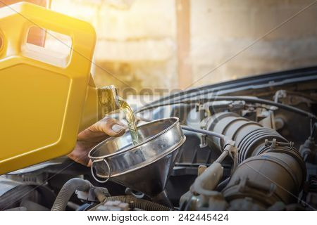 Technician Checking Engine And Refueling. Auto Mechanic Checking Car Engine. Maintenance Checking Ca