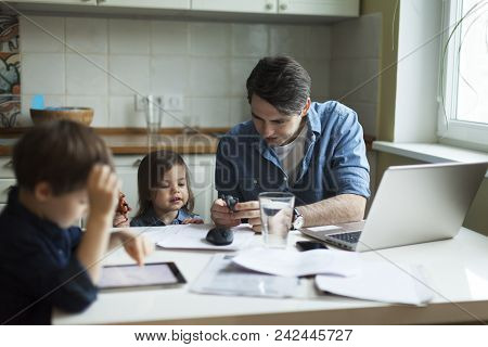 Father Working On Laptop. Businessman Working From Home And Watching Children. Spending Time With Ki