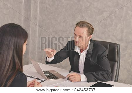 Business Concepts. Businesspeople Is Working In Office. The Business People Are Serious. Businessmen