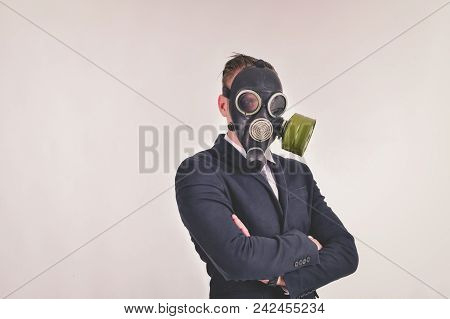Business Concepts. Businessman Wearing A Gas Mask On A White Background. Businessmen Wear Gas Masks
